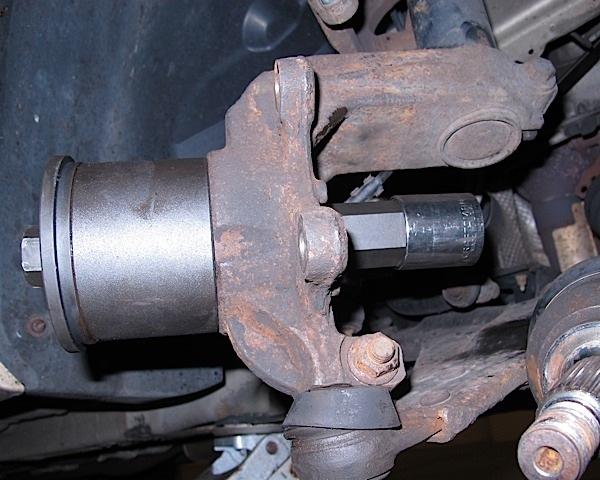 photo 7: tool in place to remove wheel bearing