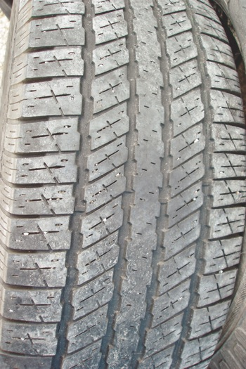 photo 1: although this tire is worn slightly at the center from over-inflation, the tread is worn evenly with no feathering at the edges of the tread ribs.