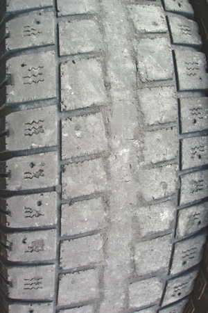 photo 4: since the outside tread ribs are largely intact, this tire has obviously suffered from over-inflation.