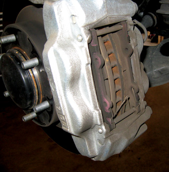 Figure 3: To fit the larger brake caliper, it is necessary to trim the backing plate/dust shield.