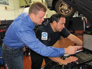 tom palermo, (left) lead diagnostician, assists in the training of technician tom dejesus on interpreting scan data on a customer's vehicle with a ­driveability issue.