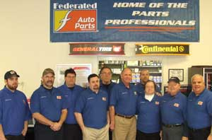 Larry Weathers III (sixth from left) and the team at Weather Motors are honored as the Federated Shop of the Year.